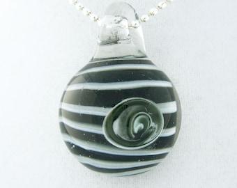 Black and white eye striped, hand blown boro glass pendant