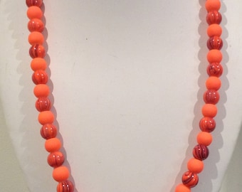 Necklace 58cm Feautures 10mm round Enamelled Glass beads. Bright orange. Black swirly patterns. All unique