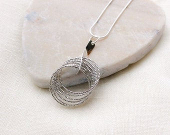 Faceted Multi Ring Silver Plated Pendant