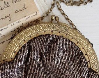 Petite vintage hand made purse/evening bag~Metallic textile and gilt metal frame~In beautiful condition~Just fits lipstick, Amex & compact!