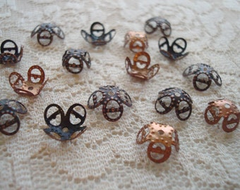 30 Copper Filigree 4 Petal Lotus Flower Caps.  Dark, Antiqued Copper or Red 8x5 to 10x4mm.  Pliable Adjustable.  USPS Ship Rates