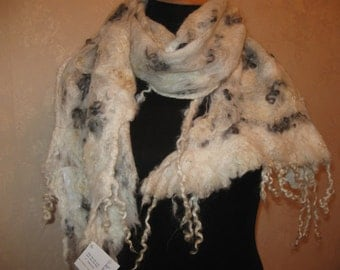 White scarf for lovers of ethnic and boho fashion . Woolly Merino wool and a large number of sheep curls and fleece.