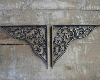 A pair of large cast iron curled vine brackets AL20