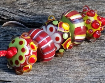 Handmade lampwork Artisan glass bead set green white red purple bead set.