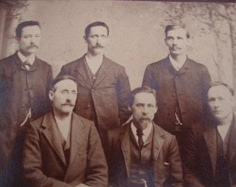 Six Men Five Mustaches
