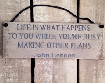 rustic sign, life is what happens to you, while you're busy, john lennon
