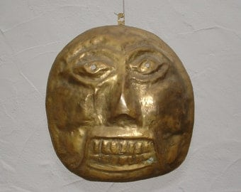 Abstract brass wall mask around 1970