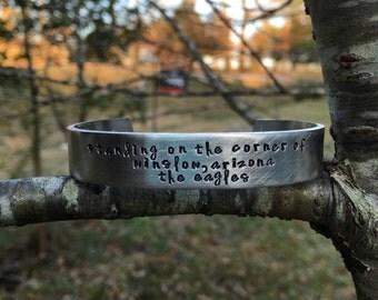 Eagles - glenn frey - Classic rock gift   hand stamped bracelet   engraved silver bracelet   Standing on the corner of winslow Arizona