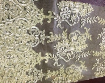 Yellow mesh lace fabric french design. Sold by the yard