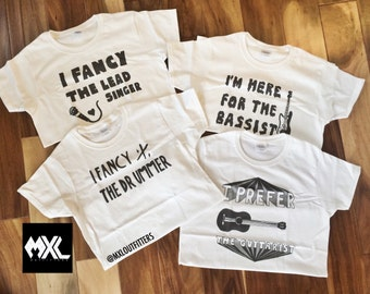 Set of 4 Band T-Shirts: I fancy the lead singer, I'm here for the bassist, I fancy the drummer, I prefer the guitarist ©