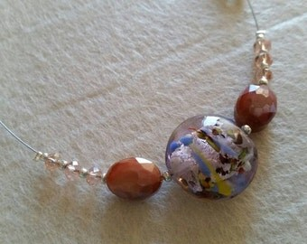 Necklace with crystals and glass with silver leaf