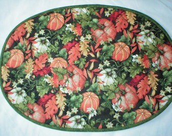 Set of 4 Quilted Oval Placemats - Pumpkins and Leaves on Black Background - Reverses to Green