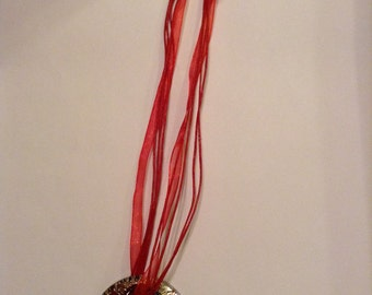 Red ribbons and melifori glass pendant