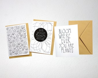 Black/white card, A6, floral theme, folded, blank inside, with envelope.