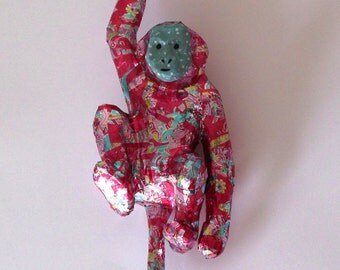 Hanging decoupage jazzy monkey - papier mache monkey covered in pink shiny wrapping paper