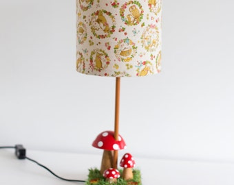 Woodland nursery natural wooden toadstool lamp with retro woodland creatures barrel lamp shade featuring fox, deer and rabbit