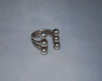 Sterling silver ring size 5 adjustable.