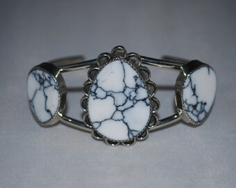 Nickel silver cuff bracelet with howlite setting.