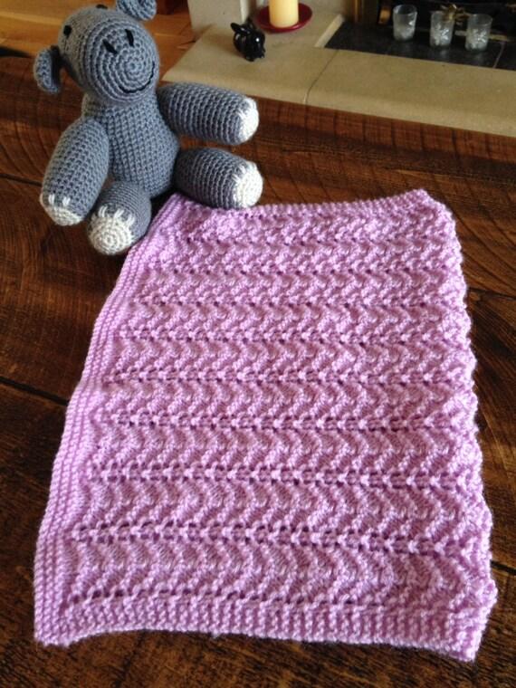 Handmade knitted baby car seat blanket