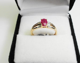 Ruby Ring.  6 x 4 mm. Natural Ruby in a 10kt. Gold Ring with Diamond Accents.