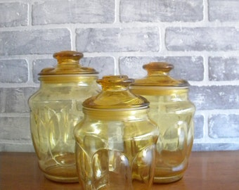 Trio of Vintage Amber Glass Container Jars with Lids