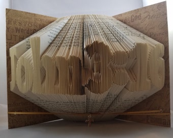 Book Art - folded ---   hardcover book folded to say   John 3:16  (for God so loved the world)