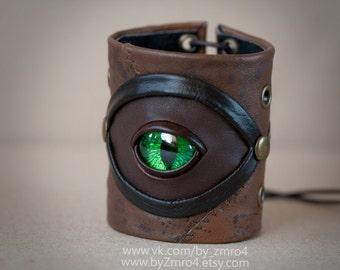 Handmade leather wide postapocalypse bracelet cuff bangle with green eye. Dragon fantasy eye bracelet cuff.