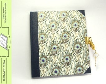 Diary with lock peacock feathers