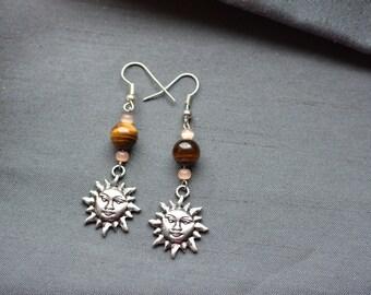 Earrings, Tiger eye, and Sun symbol