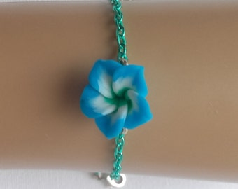 Blue flower on aqua colored chain.