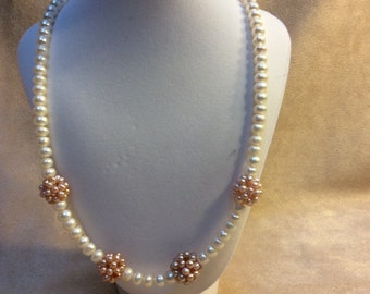 Cultured pearls with Sterling silver clasp 21""