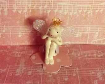 sitting fairy, fairy, fairy doll