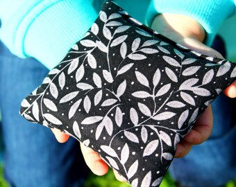 Reusable rice-filled handwarmers