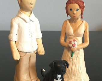 Custom clay keepsake bride and groom (and pet) wedding cake toppers