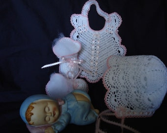 White trimmed pink bonnet, bootie and bib set