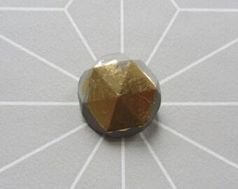 Concrete brooch facet gem