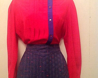 Pink and navy blue satin feel blouse with off center buttons and trim