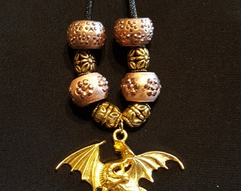 Gold dragon pendant with earth tone beads
