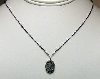 Silver Orion constellation pendant