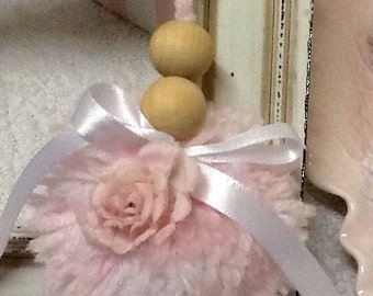 Beautiful Pompom drop. Soft pink yarn and wooden beads.