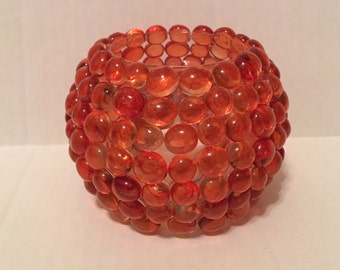 Orange glass tea light holder