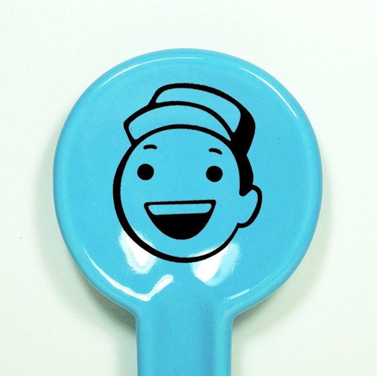 "spoon rest featuring a dude we think is saying ""Hey!"" shown here in Cloudless - Made to Order/Pick Your Colour"