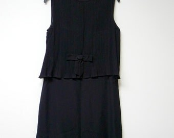 "50s 60s black electric pleated . straight cut dress . fits like a medium to large . 36"" bust . union made / made in USA"