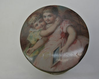 Tin with sweet images of children and dolls
