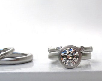 Bezel set diamond and platinum wedding ring set, 1.5ct diamond engagement ring, diamond eternity ring and plain wedding bands
