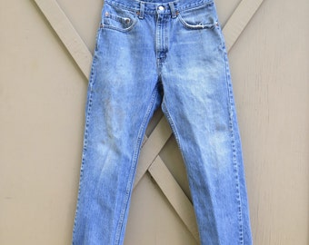 Distressed vintage Levi's 505 Regular Fit Straight Leg Faded Denim Jeans