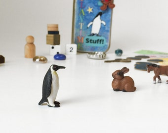 Tiny toys in a wee tin box with penguin, rabbit and horse. Fun collection of random toys for kids. Busy box, activity tin, learning toys.