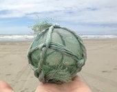 Japanese Glass Fishing Float - Baseball Size, Original Net, Light Green