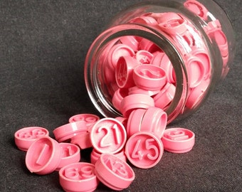 Lucky numbers. Vintage pink plastic bingo game calling markers. Set of 6.