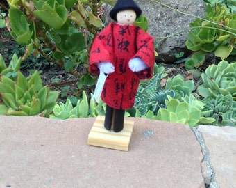 China clothespin doll - black and red outfit